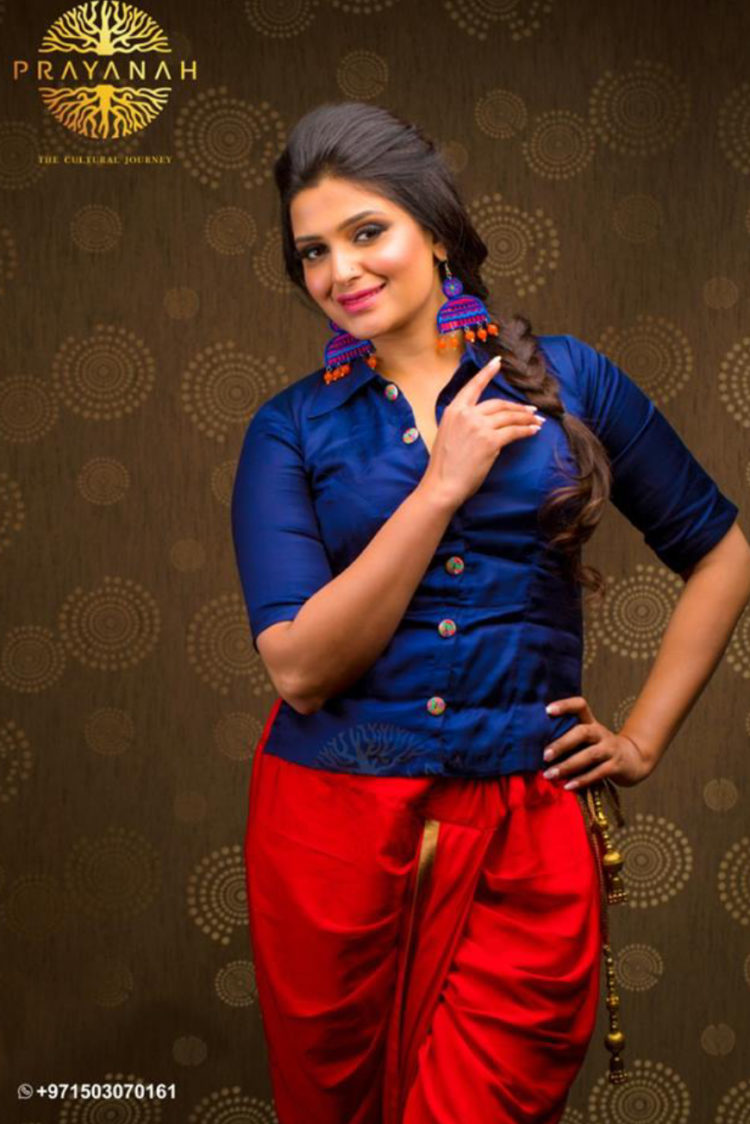 Blue embroidered shirt with a gorgeous red dhoti